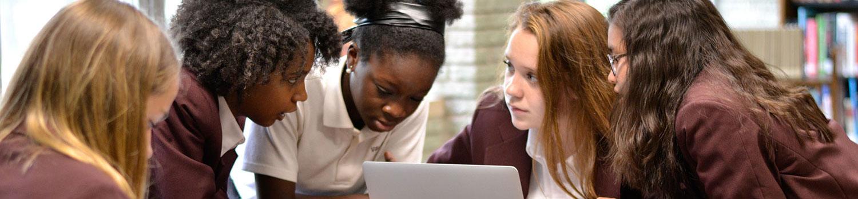 Girls around Laptop